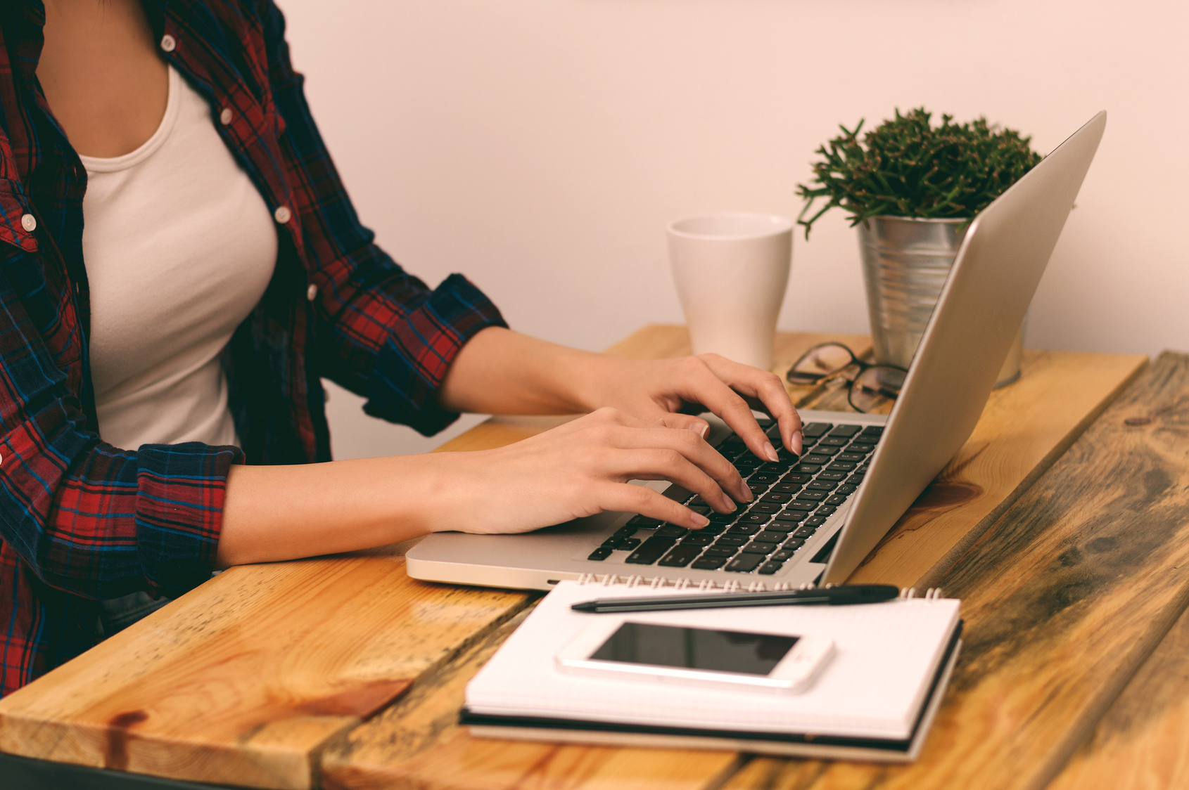 Woman freelancer, student or blogger typing on computer sitting at home office